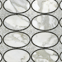 Solid Ovals, a natural stone hand cut and waterjet mosaic shown in Calacata Tia and polished Nero Marquina, is part of the Silk Road Collection by Sara Baldwin for New Ravenna Mosaics. <br />