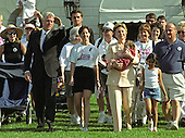 United States President Bill Clinton and first lady Hillary Rodham Clinton participate in the Million Mom March showing their support for stronger gun laws in the U.S. on the South Lawn of the White House in Washington, D.C. on May 14, 2000.  Also pictured are march organizer Christine O'Brien of Trenton, New Jersey, and her daughter Bridget, who is being carried by Mrs. Clinton.<br /> Credit: Ron Sachs / CNP