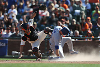 SAN FRANCISCO, CA - APRIL 27:  Nick Hundley #5 of the San Francisco Giants applies a late tag at home plate as Los Angeles Dodgers base runner #26 Chase Utley slides home safely during the game at AT&T Park on Thursday, April 27, 2017 in San Francisco, California. (Photo by Brad Mangin)