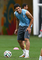Luis Suarez of Uruguay laughs as he trains in the Arena Corinthians, Sao Paulo ahead of his sides Group D crunch fixture vs England tomorrow