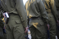 Ultra-Orthodox Jewish fighter from the Netzah Yehuda Battalion in the Israeli army, holds a bible during his swearing-in ceremony on Ammunition Hill in Jerusalem.