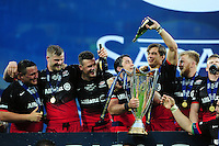 Saracens players celebrate with the European Rugby Champions Cup trophy. European Rugby Champions Cup Final, between Saracens and Racing 92 on May 14, 2016 at the Grand Stade de Lyon in Lyon, France. Photo by: Patrick Khachfe / Onside Images