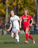 Boston College midfielder Julia Bouchelle (12) one time pass as Marist College midfielder Melanie Rigo (30) closes. Boston College defeated Marist College, 6-1, in NCAA tournament play at Newton Campus Field, November 13, 2011.