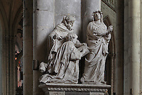 Sculpture group on the tomb of Antoine Niquet, died 1652, priest and canon, with the deceased kneeling, presented by his patron saint St Anthony, to the Virgin, sculpted 1652 by Nicolas Blasset, 1600-59, French sculptor, in the nave of the Basilique Cathedrale Notre-Dame d'Amiens or Cathedral Basilica of Our Lady of Amiens, built 1220-70 in Gothic style, Amiens, Picardy, France. Amiens Cathedral was listed as a UNESCO World Heritage Site in 1981. Picture by Manuel Cohen
