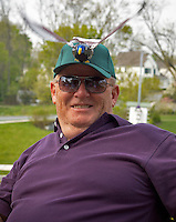 Man with humorous mechanical bird cap at dedication of purple martin bird house.