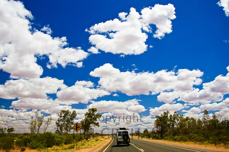 Four-wheel-drive vehicle on road in the Red Centre, Australia