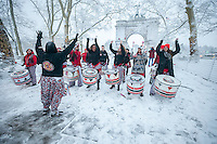 "All women percussion group Batala performs at the 40th Annual ""Eggs on End: Standing on Ceremony"" spring equinox celebration in Grand Army Plaza in Brooklyn in New York welcoming in the first day of spring on Friday, March 20, 2015.  At the precise moment of the Spring Equinox, this year at 6:45 PM, a raw egg can be stood on its end bringing good luck for the rest of the year. This year Mother Nature welcomed in Spring with with a snowstorm depositing three inches in New York.  (© Richard B. Levine)"