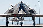Making its way down the flightline, F-117A AF 88-0843 named 'Affectionately Christine', was the last F-117A off the Lockheed Martin production line. Later the aircraft would adorn the American Flag paited on her underside as she would be the last F-117A to be flown to the Tonopah Test Range in Nevada by Lt. Col John K. Forsythe to be retired. Here the aircraft is seen taking part in the 25-ship formation flight to celebrate the 25th Anniversary of the F-117A Night Hawk.