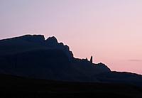 Silhouette of Old Man of Storr in dawn light, Isle of Skye, Scotland