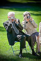 A pair of wedding guests with cameras will probably end up with very similar photos of the wedding ceremony. (Photo by Scott Eklund/Red Box Pictures)