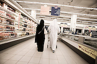 Qatar - Doha - Qatari couple shopping at carrefour