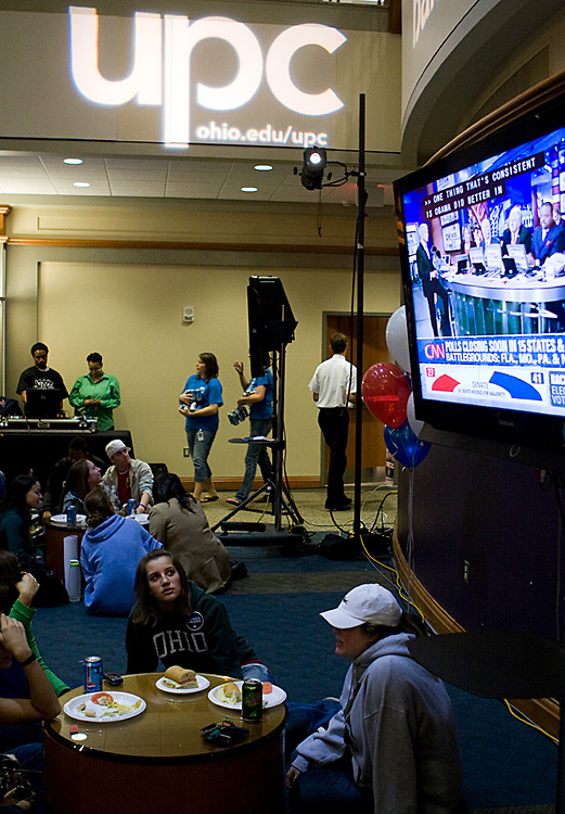 6. Students sit in the second floor lobby watching multiple TVs during.the UPC Election Results Party at Baker Center on November 4th, 2008.