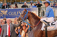 HALLANDALE BEACH, FL - MARCH 04:  Gunnevera (KY) with jockey Javier Castellano and owner, Salomon Del Valle, in the winners circle after winning the $400,000 Xpressbet Fountain Of Youth Stakes (Grade II) at Gulfstream Park on March 04, 2017 in Hallandale Beach, Florida. (Photo by Liz Lamont/Eclipse Sportswire/Getty Images)