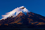 Snowcapped Cotopaxi Volcano seen from the high plains of Cotopaxi National Park in Ecuador.  Cotopaxi is a stratovolcano and one of the highest active volcanoes in the world.