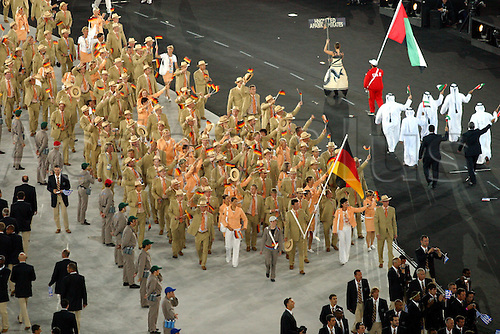 13.08.2004: Athens, Greece.   German flag bearer LUDGER BEERBAUM leads athletes from Germany on the parade around the stadium during the Opening Ceremony of 2004 Olympic Games held in the Olympic Stadium, Athens, Greece.