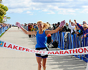 Nacole Fredrickson (first name spelling consistent with her name in other races) of Milwaukee crosses the finish line in 3:01:42 as the first place female in the Milwaukee Lakefront Marathon on Sunday, Oct. 3, 2010. Ernie Mastroianni photo.