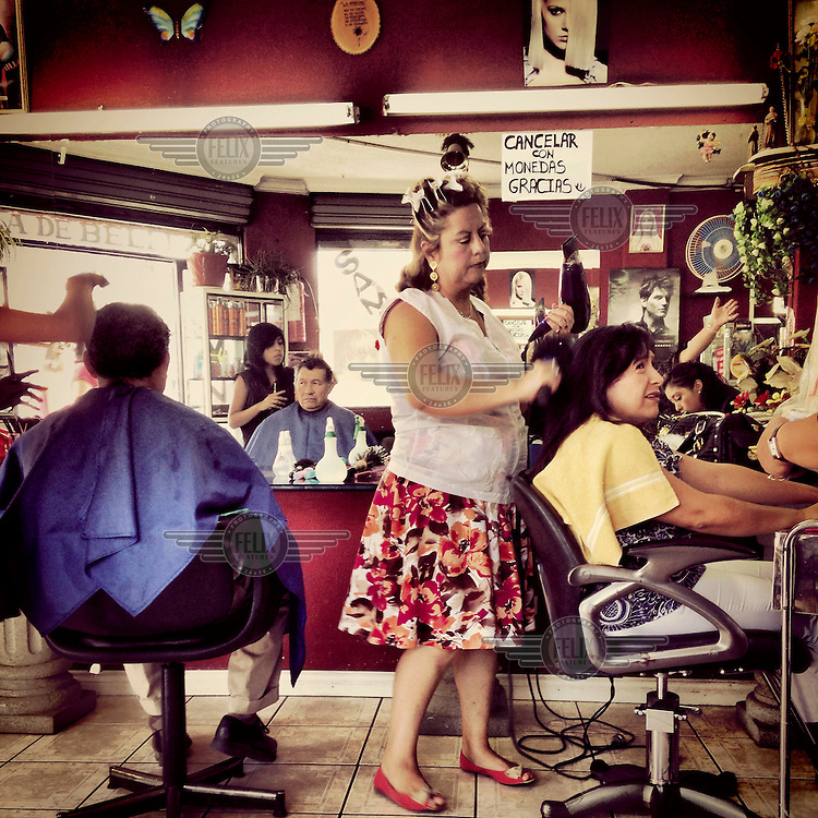 Ximena Arias a hairdresser and owner of Alta Peluqueria, where she has been working for decades.