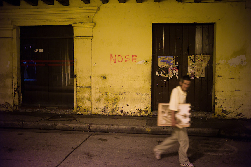 Grafitti and pedestrian, Cartagena, Colombia.
