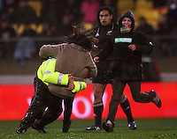 A security guard tackles a pitch invader as her accomplice and All Blacks second five Ma'a Nonu look on during the International Test Match between the NZ All Blacks and France at Westpac Stadium, Wellington, New Zealand on Saturday 20 June 2009. Photo: Dave Lintott / lintottphoto.co.nz