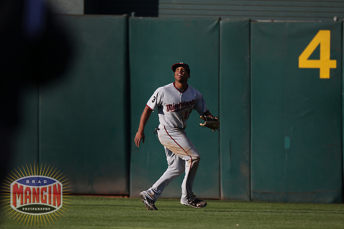 OAKLAND, CA - JULY 30:  Ben Revere #11 of the Minnesota Twins makes a play in center field against the Oakland Athletics during the game at the Oakland-Alameda County Coliseum on July 30, 2011 in Oakland, California. Photo by Brad Mangin