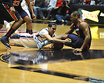 "Ole Miss' Anthony Perez (13) and Auburn guard Brian Greene Jr. (24) vie for a loose ball at the C.M. ""Tad"" Smith Coliseum on Saturday, February 23, 2013.  (AP Photo/Oxford Eagle, Bruce Newman)"