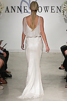 "Model walks runway in a Nobel Bridal gown - ivory, gold and opaque white beaded halter gown, from the Anne Bowen Bridal Spring 2013 ""Coat of Arms"" collection fashion show, during Bridal Fashion Week New York April 2012."