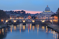 Ponte Vittorio Emanuele II (Vittorio Emanuele II bridge) at twilight, Ennio de Rossi, Rome, Italy. Though De Rossi s design was made in 1886 the bridge was not inaugurated until the year 1911. It connects the historical centre of Rome to the Vatican City, dome of Saint Peter's Basilica visible in the distance. It consists of three arches spanning a distance of 110 metres. Picture by Manuel Cohen