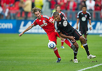 August 21 2010   D.C. United defender Jordan Graye #16 and Toronto FC forward Mista #10 in action during a game between DC United and Toronto FC at BMO Field in Toronto..DC United won 1-0.