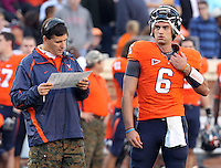 Nov 13, 2010; Charlottesville, VA, USA; Virginia Cavaliers Bill Lazor Offensive Coordinator/QB Coach with Virginia Cavaliers quarterback Marc Verica (6) during the game against the Maryland Terrapins at Scott Stadium. Maryland won 42-23.  Mandatory Credit: Andrew Shurtleff