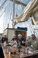 Isle of Islay, Hebrides, Scotland, May 2010. a Whisky tasting session on the deck of Thalassa in the late afternoon sun. Dutch Tallship Thalassa sails between the islands along the Scotish west coast in search of the quality single malt whisky that is produced by the many distilleries. Photo by Frits Meyst/Adventure4ever.com