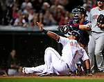 4 September 2009: Cleveland Indians' second baseman Luis Valbuena slides home safely to score in the 6th inning against the Minnesota Twins at Progressive Field in Cleveland, Ohio. The Indians defeated the Twins 5-2 to take the first game of their three-game weekend series. Mandatory Credit: Ed Wolfstein Photo