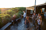 CAPE TOWN, SOUTH AFRICA MAY 17: People watch the sunset as they stay at Slangkop Camp on May 17, 2014 outside Cape Town, South Africa. The city offers many different hiking trails and nature experiences close to the city center. (Photo by: Per-Anders Pettersson)