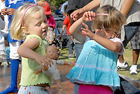 Children dance at Clover Park during the 20th Annual Santa Monica Festival on Saturday, May 7, 2011.