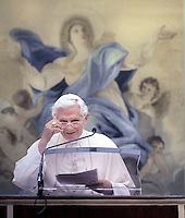 Pope Benedict XVI blesses pilgrims during his Angelus prayer ahead of a mass to mark the Assumption Day, honoring the Virgin Mary in the church of his summer residence in Castel Gandolfo, in the outskirts of Rome, on August 15, 2011