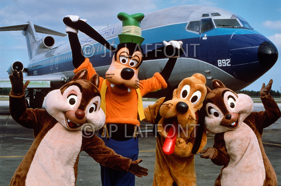 infront of private Disney World airplane. Disney World is a world ...
