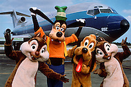 Orlando, Florida - Circa 1986. Walt Disney Production characters Goofy (wearing hat), Pluto (dog) and Chip 'n' Dale (the chipmunks) stand infront of private Disney World airplane. Disney World is a world-renowned entertainment complex that opened October 1, 1971 in Lake Buena Vista, FL. Now known as the Walt Disney World Resort, the property covers 25,000 acres and has an annual attendance of 52.5million people.