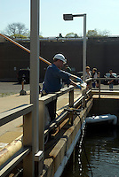 Worker checks samples of de-chlorinated water prior to discharge nto the Hudson River. Yonkers Sewage Treatment Plant in the city of Yonkers, NY in Westchester County on Saturday, April 25, 2009. (© Richard B. Levine)