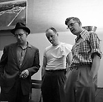 Pittsburgh PA: Brady Stewart Jr. discussing a photo shoot with two art directors at Brady Stewart Studio - 1956.