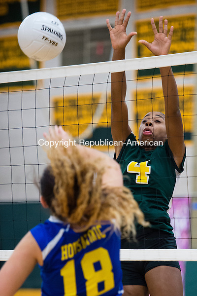 WATERBURY, CT- 27 October 2015-102715EC08-  Holy Corss' Meah Austin blocks a spike from Housatonic. The Crusaders swept the matches at home Tuesday night. Erin Covey Republican-American