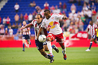 Nick LaBrocca (10) of CD Chivas USA and Dane Richards (19) of the New York Red Bulls battle for the ball. The New York Red Bulls and CD Chivas USA played to a 1-1 tie during a Major League Soccer (MLS) match at Red Bull Arena in Harrison, NJ, on May 23, 2012.