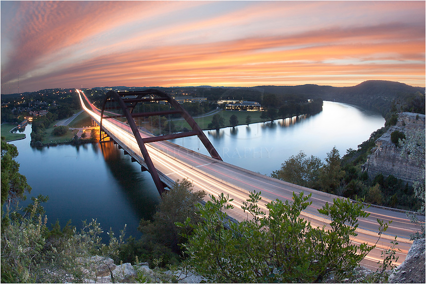 This image of Pennybacker Bridge near Austin Texas was taken with a fisheye lens. I knew it would be a good sunset, so I headed to one of my favorite places - the cliffs above the 360 Bridge - and waited for the light show to being. This was my reward.