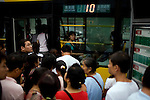 People crowd to catch a bus in downtown Beijing, China on Sunday, August 10, 2008.  Kevin German