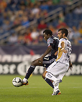 New England Revolution forward Kenny Mansally (7) passes as Pumas UNAM midfielder Jehu Chiapas (13) pressures. The New England Revolution defeated Pumas UNAM in SuperLiga group play, 1-0, at Gillette Stadium on July 14, 2010.