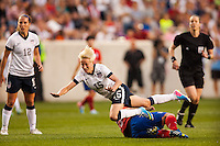 United States (USA) midfielder Megan Rapinoe (15) is foiled by Korea Republic (KOR) midfielder Kim Narae (15). The women's national team of the United States defeated the Korea Republic 5-0 during an international friendly at Red Bull Arena in Harrison, NJ, on June 20, 2013.