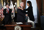 United States Vice President Mike Pence (C) congratulates Nikki Haley at the end of the ceremony where she was sworn in as the U.S. Ambassador to the United Nations January 25, 2017 in Washington, DC. Haley was formerly the Governor of South Carolina. Also pictured is US Senator Marco Rubio (Republican of Florida). <br /> Credit: Win McNamee / Pool via CNP