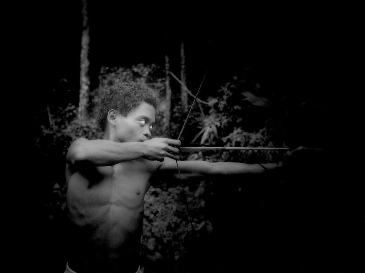 A hunter: Agta man (Tero) with bow and arrow, Sierra Madre Mountains, Philippines.  Tero has the lean body of a rainforest hunter without an gram of extra weigh on his frame and nor flamboyant steroid induced bulk.