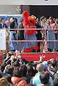 Elmo of Sesame Stree throws roasted soy beans and snacks toward people at Tokyo's Zojoji temple as part of the Setsubun festival which marks the lunar calendar start of spring. The beans are supposed to drive away the evil spirits that bring misfortune and bad health with them.