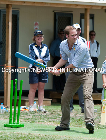 """PRINCE WILLIAM.Prince William visited the Flowerdale Community, where families who lost their homes last year in the bushfires live in temporary housing. Whilst at the Community event the Prince participated in cooking some sausages and burgers on a BBQ with Bill Shorten Mister for infrastructure and reconstruction. The Prince then moved on for some drinks with the families before playing cricket with Bret Lee and Matt Hayden. Before leaving the community William planted a tree. Flowerdale, Shire of Murrindindi_21/01/2010.Mandatory Credit Photo: ©DIAS-NEWSPIX INTERNATIONAL..**ALL FEES PAYABLE TO: """"NEWSPIX INTERNATIONAL""""**..IMMEDIATE CONFIRMATION OF USAGE REQUIRED:.Newspix International, 31 Chinnery Hill, Bishop's Stortford, ENGLAND CM23 3PS.Tel:+441279 324672  ; Fax: +441279656877.Mobile:  07775681153.e-mail: info@newspixinternational.co.uk"""