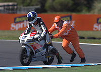 A track Marshall pushes FTR Honda Moto3 rider John Mcphee of Britain during the first practice session of the Australian Motorcycle Grand Prix in Phillip Island near Melbourne. Oct 18, 2013. Photo by Daniel Munoz/VIEWpress IMAGE RESTRICTED TO EDITORIAL USE ONLY- STRICTLY NO COMMERCIAL USE.