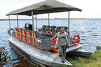 Africa, Botswana, Kasane, Chobe Game Lodge, Chobe National Park. Announcement of the new solar powered electric safari game viewing vehicle and boat that will start the fleet at Chobe Game Lodge. Women guides on the electric boat.